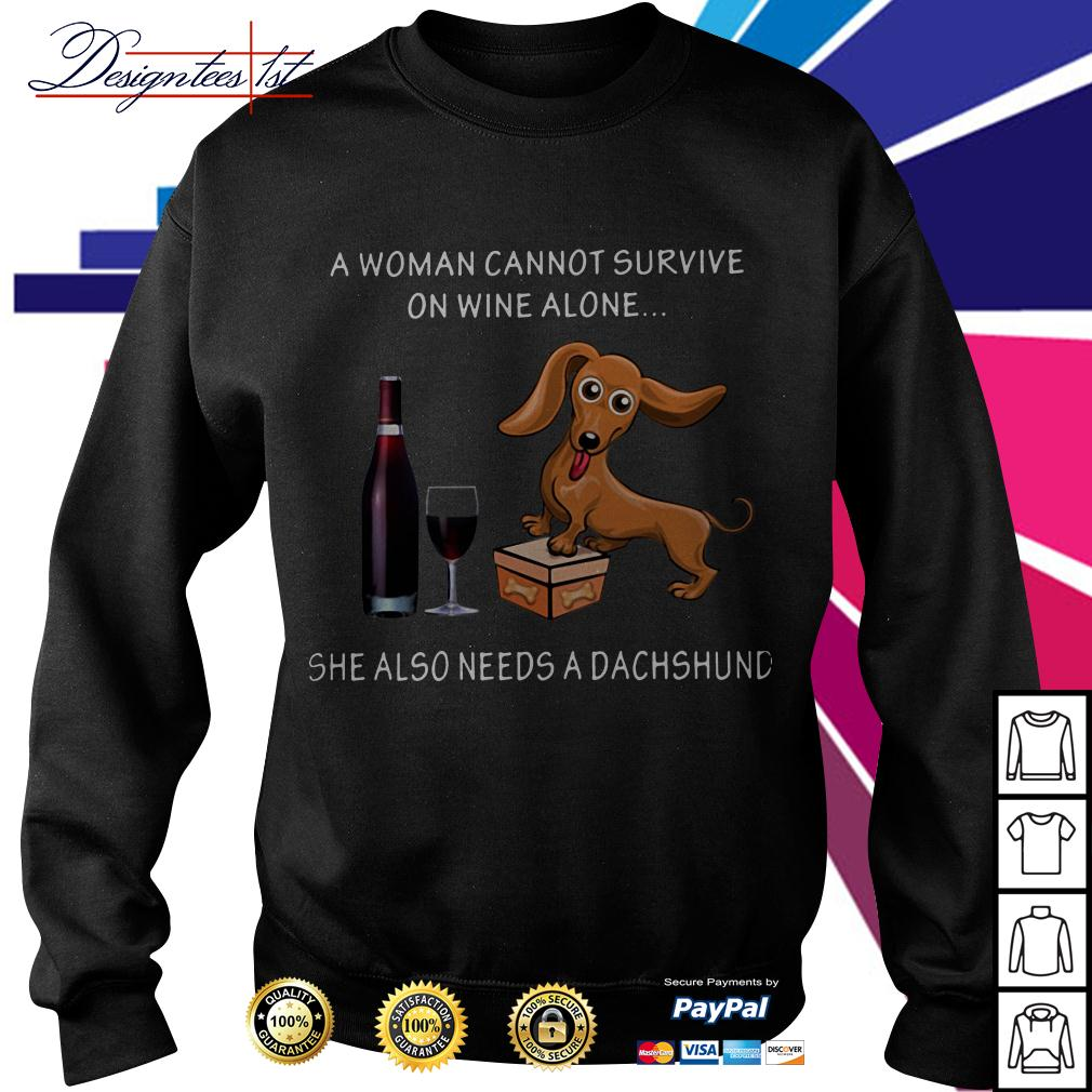 A woman cannot survive on wine alone she also needs a Dachshund Sweater