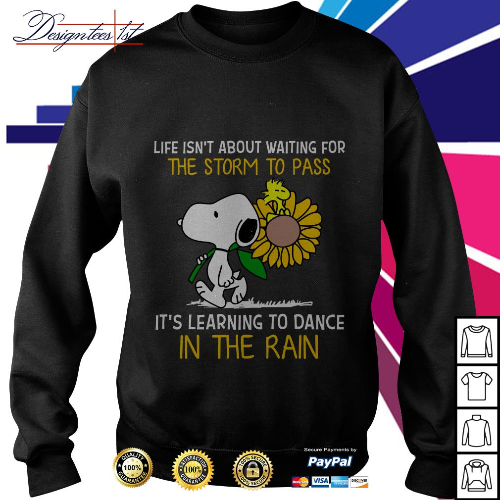 Snoopy and Peanut life isn't about waiting for the storm to pass it's learning to dance in the rain Sweater