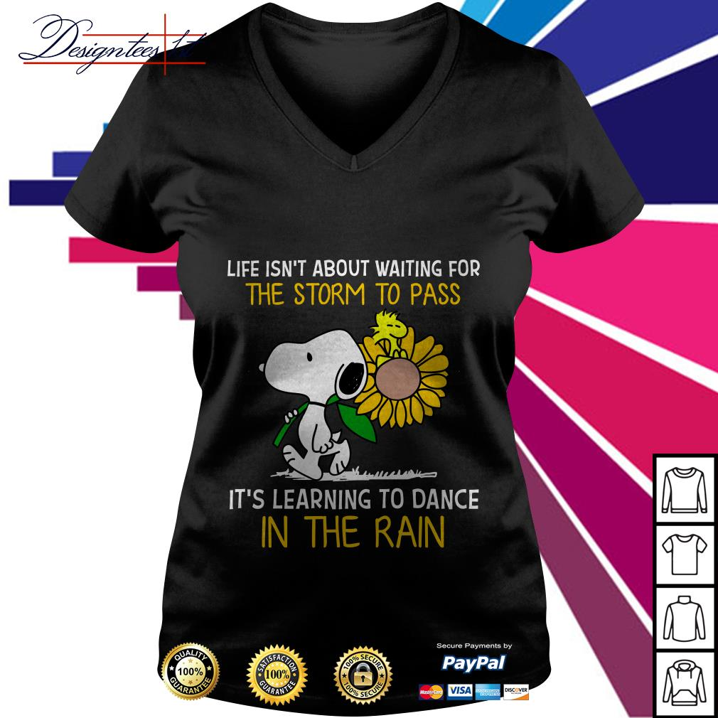 Snoopy and Peanut life isn't about waiting for the storm to pass it's learning to dance in the rain V-neck T-shirt